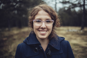 Winter Portrait of a Smiling Woman With Glasses