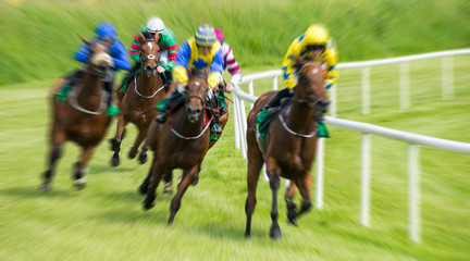 Race horses and jockeys motion blur zoom effect