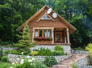 Cottage from logs in the forest