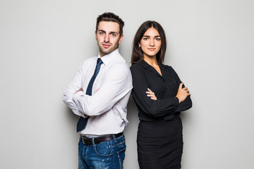 Man and woman standing back to back on gray background