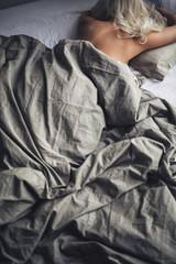 Beautiful Blonde Woman Sleeping in Bed