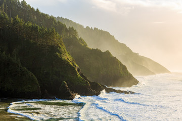 Golden hour light hits the Oregon Coastline at the Heceta Head Lighthouse