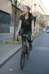 Cyclist riding on city Street