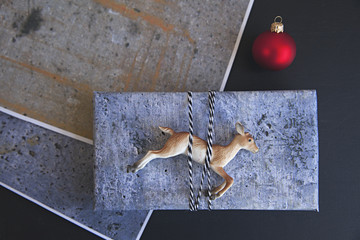 handmade / DIY concrete style gift wrap for Christmas on black background