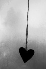 Heart  Silhouetted Against a Frosted Window