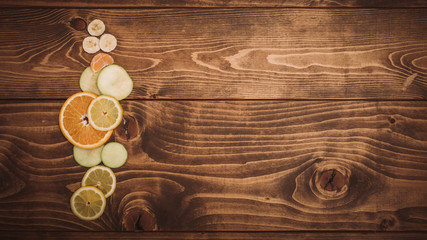 Fresh organic fruits on wooden table