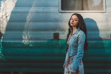 Young Woman with a Vintage Trailer