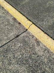 Detail of curb along sidewalk and residential street
