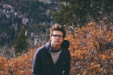 Young man walks up mountain