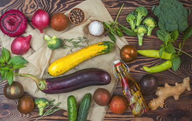 Fresh organic vegetables from the garden on wooden background. Top view Copy space