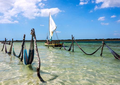 Sail boat and hammocks at the Paradise Lake, Jericoacoara, Brazil