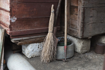 Hangar with broom and hoe
