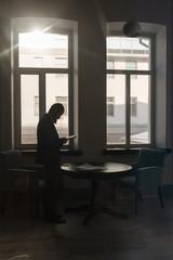 Man standing near table