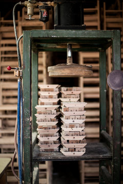 wood press stacked with wood spindles in workshop
