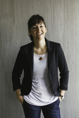 Casual business woman in white t-shirt and black blazer