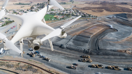 Unmanned Aircraft System (UAV) Quadcopter Drone In The Air Over Construction Site.