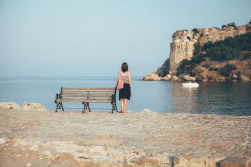 Young woman gazing at Mediterranean Sea in Koroni, Greece