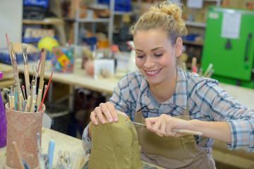 Jolly female artist at work