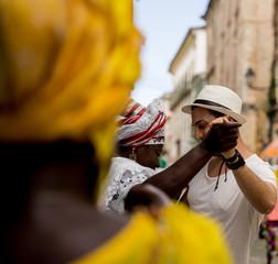 """Brazilian women """"Baiana"""" dancing in Pelourinho, Salvador, Bahia, Brazil"""