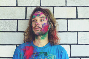 Guy dirty with colorful powder used for Holy celebration