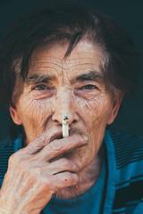 Portrait of an senior woman smoking