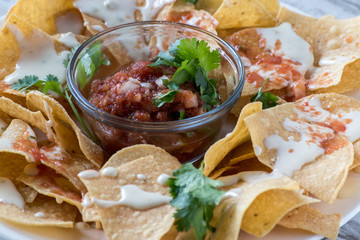 mexican nachos with salsa and tortilla chips