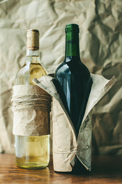 Two wrapped red and white wine bottles.