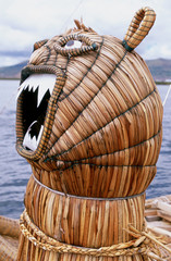 Animal head in front of a reed boat