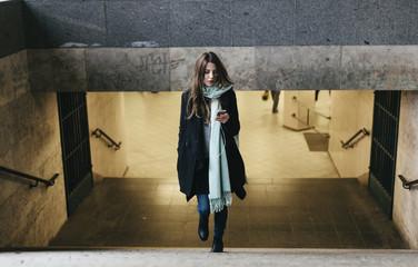 Woman leaving Subway Station