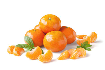 Unpeeled ripe tangerines, mandarines, clementines with slices isolated on white background