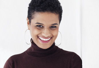 Portrait of a beautiful smiling woman on white