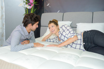 Couple viewing new mattress