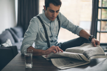 Young Man Reading Morning Newspaper