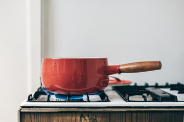 Red pot on gas cooker