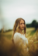 Portrait of a young girl in a field