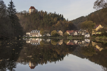Ziegenrueck, Thuringia, Germany - small town reflected in river Saale in late fall
