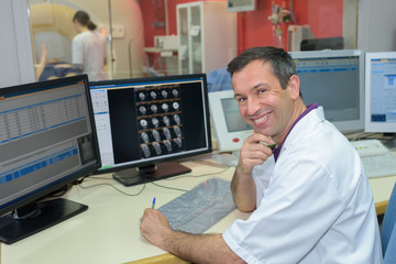 portrait of male radiologist at computers