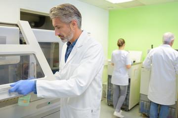 mature male scientist in his lab