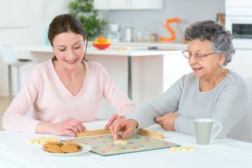 Two women playing scrabble