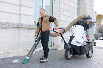 Man using street cleaning machine