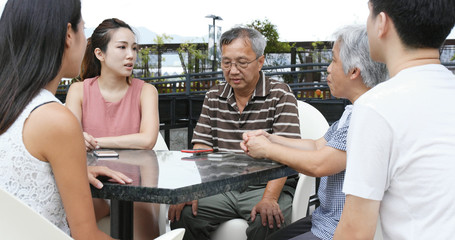 Family talking at outdoor coffee shop
