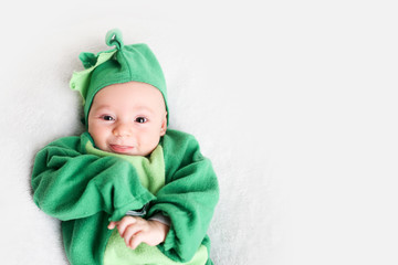 Baby dressed up in a dinosaur costume for Halloween
