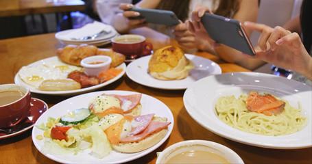 Women taking photo on English breakfast