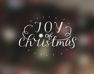 Hand lettering Joy of christmas with star.