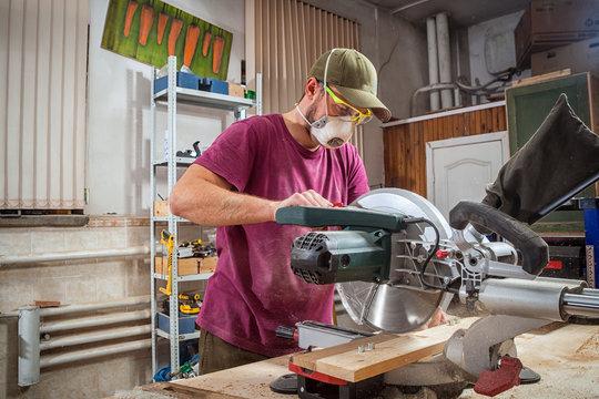 man carpenter cut wooden