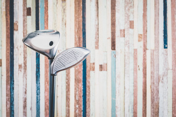 retro golf club with vintage old wooden background with copy space
