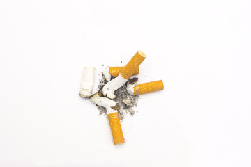 cigarette butts on a isolated white background close up composition photography