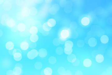 Abstract blue circular bokeh background.