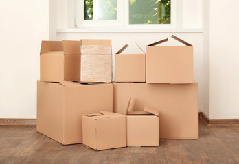 Move house concept. Carton boxes on floor in empty room