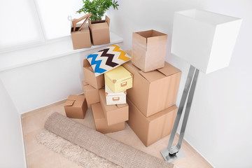 Move house concept. Carton boxes and belongings in empty room